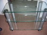 Glass tv stand on wheels FREE TO GOOD HOME