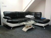 Corner Sofa with Oval Glass Coffee Table.