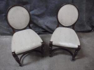 2 chairs, very detailed wood frame, white patterned fabric back and seat