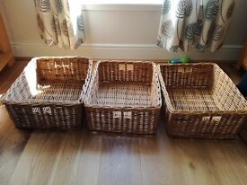Three matching large wicker baskets