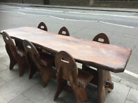 Handmade Trencher Style Table and 6 matching chairs . Chairs are handmade with leather seat covers