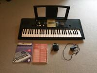 Yamaha Keyboard With music books and pedal