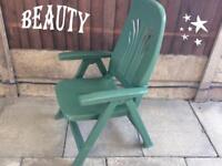 Green plastic deckchair