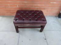 A Reddish Leather Chesterfield Foot Stool