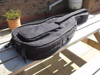 Soft cello case. For up to full-sized instrument. Used for electric cello.