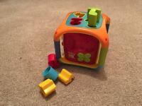 Cube with shapes and numbers