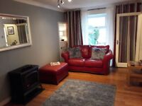Red ox blood leather sofas 1x 2 seater. 1 x 3 seater plus pouffe great condition.