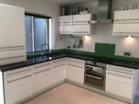 For sale modern high gloss kitchen with black granite worktop