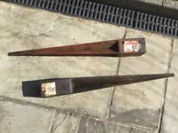 Metal spikes for wooden garden posts