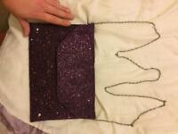 Purple Faith glitter clutch bag
