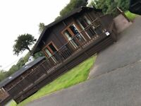 LODGE WITH DECKING & PRIVATE PARKING AT WEMYSS BAY, SCOTLAND