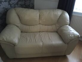 Two cream sofas one large and one two seater