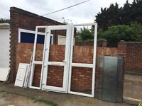 UPVC white double glazed front door (used) with side frosted glass and panels