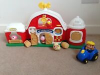 Little people barn with farm animals, hay, farmer and tractor, has buttons/sounds/music