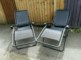 Pair of textoline sun loungers