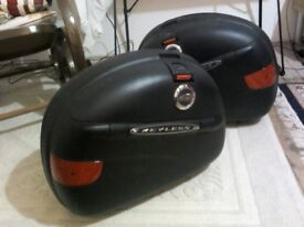 GIVI hard motorcycle panniers. Two. Black. Key/keyless entry system. Very good condition.