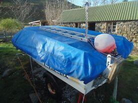 15 FOOT ski boat on trailer.