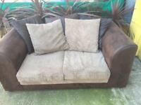 2 seater sofa with cushions in good condition