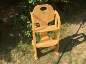 Childs wooden high chair, adjustable, great for ages 3-10 for eating at the dining table