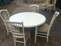 Hand painted wooden dining table with six chairs
