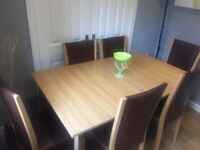 Light oak effect extending table and 6 chairs