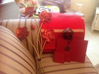 Red curtains, wall hanging placemats and coasters