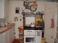 Diplomat Duel fuel mains gas/elec cooker. Blk/Cream Slight damage to top oven door not visual