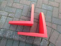 pair of red IKEA shelfs