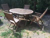 WOODEN OVAL TABLE & 4 CHAIRS