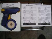 Bombo strap locker or strap dispenser gun in original box as new with instruction book