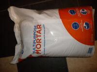unopened bag of mortar