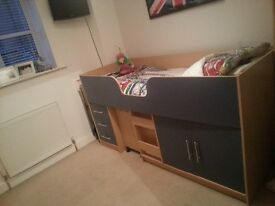 Single cabin bed with under bed cupboard, drawers and pull out desk. Mattress not included.