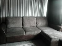 corner sofa, with storage, pull out foot rest and double sofa bed.