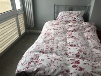 Single bed with mattress for sale.