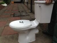 White ceramic toilet and cistern