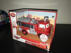 Disney Pixar cars pull back fire engine.