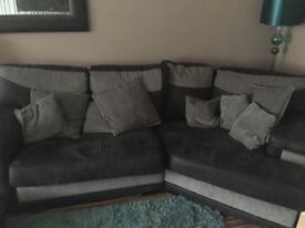 Grey and black sofa and snuggle chair