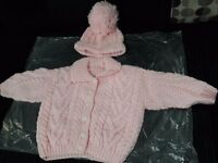 Pink hand knitted hat and cardigan set