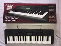 CASIO CTK-3200 Electronic Keyboard complete with original User Guide, Songbook and box.