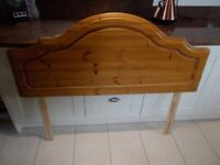 A HONEY PINE DOUBLE HEADBOARD IN GOOD CONDITION.