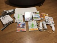 Nintendo wii console with 2 controllers, wii fit board and 7 games