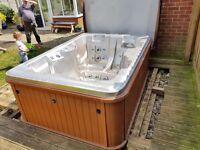 Hot tub 3-4 seater. Think its a Sunrise spa, Balboa controls