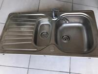 Sink with mixer taps