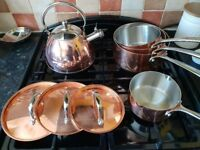 Three copper saucepans, one milk pan and a copper kettle.