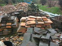Approximately 8500 second hand clay roof tiles including eaves tiles,tile and a half and ridge tile