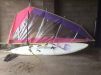 Two wind surfers