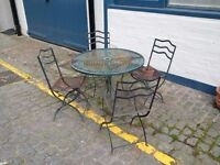 weathered garden or patio metal table and chairs set can deliver