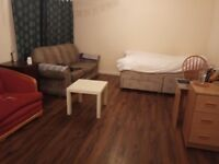 three bedrooms on level 1 with the free parking area
