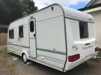 Touring caravan with awning 4 berth shower and toilet