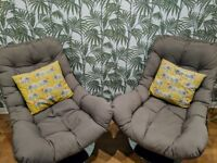 Pair of Made modern rattan swivel chairs.